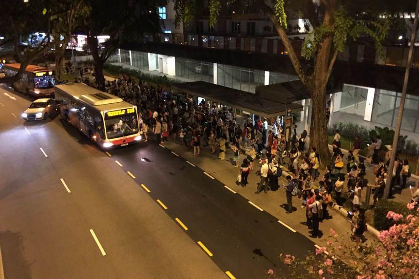 People waiting for buses outside Novena MRT station on July 7, 2015.