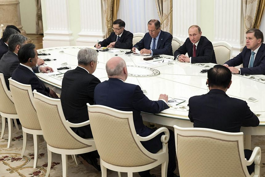 Russian President Vladimir Putin (second from right), flanked by Russian Foreign Minister Sergei Lavrov (third from right), attending a meeting of foreign ministers in the Shanghai Cooperation Organisation.