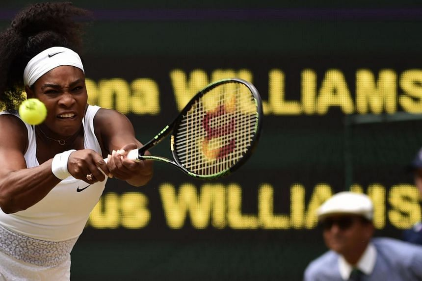 Serena Williams returns to Venus Williams during their women's singles fourth round match on day seven of the 2015 Wimbledon Championships on July 6, 2015.