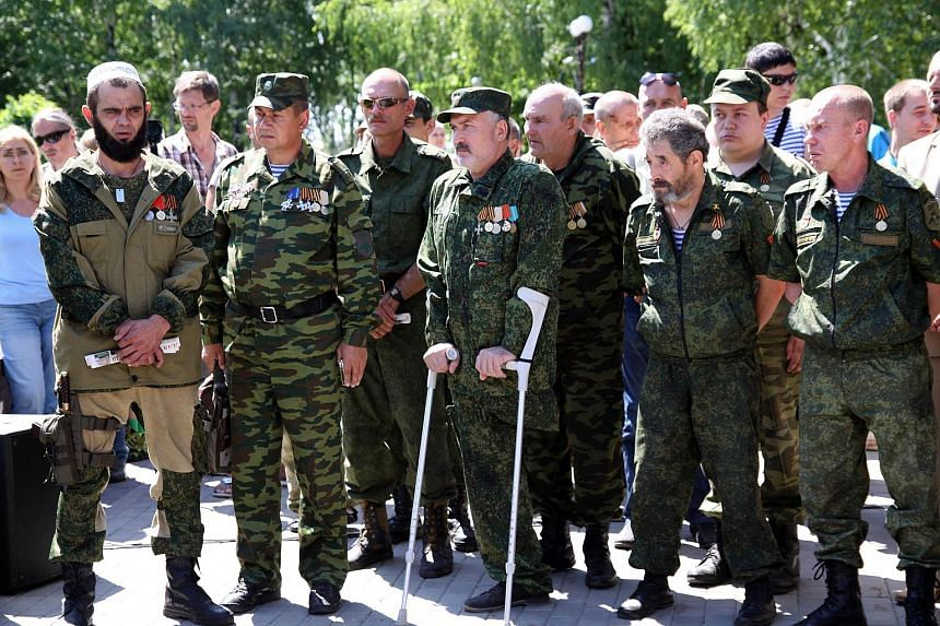 Pro-Russian separatists attend a rally marking the first anniversary of their withdrawal from Slavyansk in the Donetsk region on July 5, 2015.