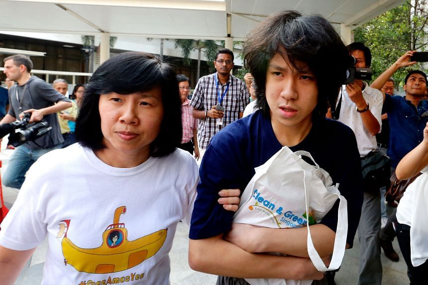 Amos Yee walking away from the State Courts yesterday evening with his mother, Madam Mary Toh. He had spent some 50 days in remand.