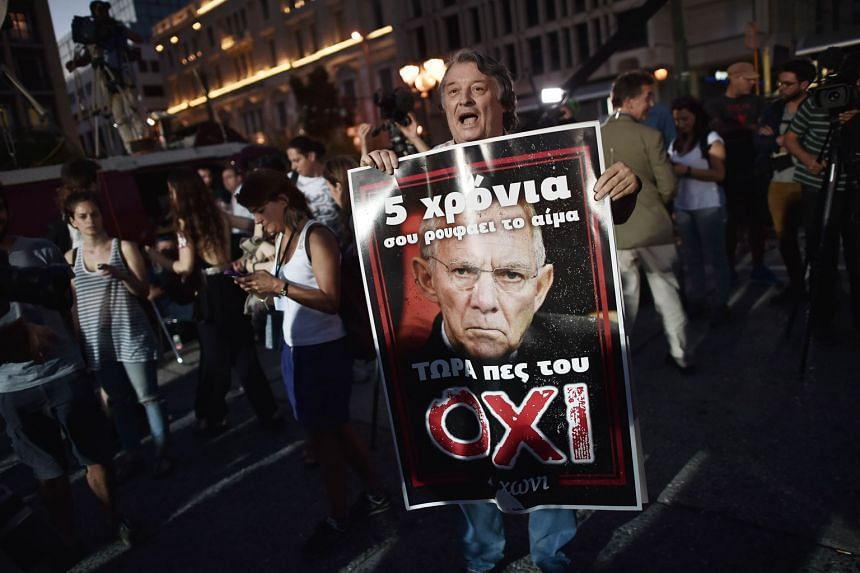 """An oxi or """"no"""" vote on a poster of German finance chief Wolfgang Schaeuble."""
