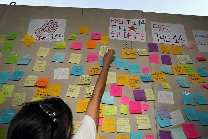 Messages calling for the release of 14 Thai students held for anti-coup protests seen at the Bangkok Art & Culture Centre.