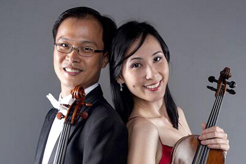 Husband-and-wife violinists Tan Wee-Hsin and Lillian Wang.