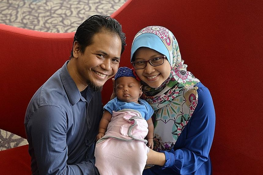 Mr Raihan Haji Rajin and Madam Siti Nurjannah with their daughter Hannah. Doctors had preserved part of Madam Siti's ovarian tissue and implanted it back after her recovery, to enable her to conceive naturally.