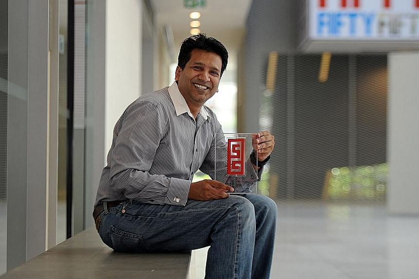 Nearex COO Mahesh Goel with the SG Mark award for the design of the XipPOS mobile point-of-sale device. Consumers with XipTAG cards tap against the device to make purchases. The system uses mobile networks as phone penetration rates are relatively hi