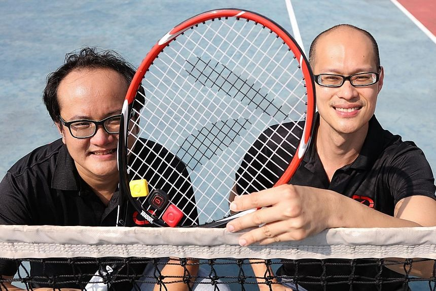 9 Degrees Freedom's co-founders Cen Lee (left) and Donny Soh with their device Qlipp, clipped to the tennis racket.