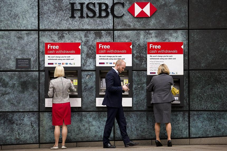 ATMs outside a HSBC bank branch in London.