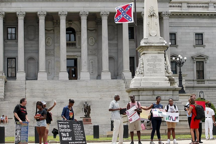 Protesters calling for the removal of the confederate flag at a confederate monument in front of the South Carolina State House.