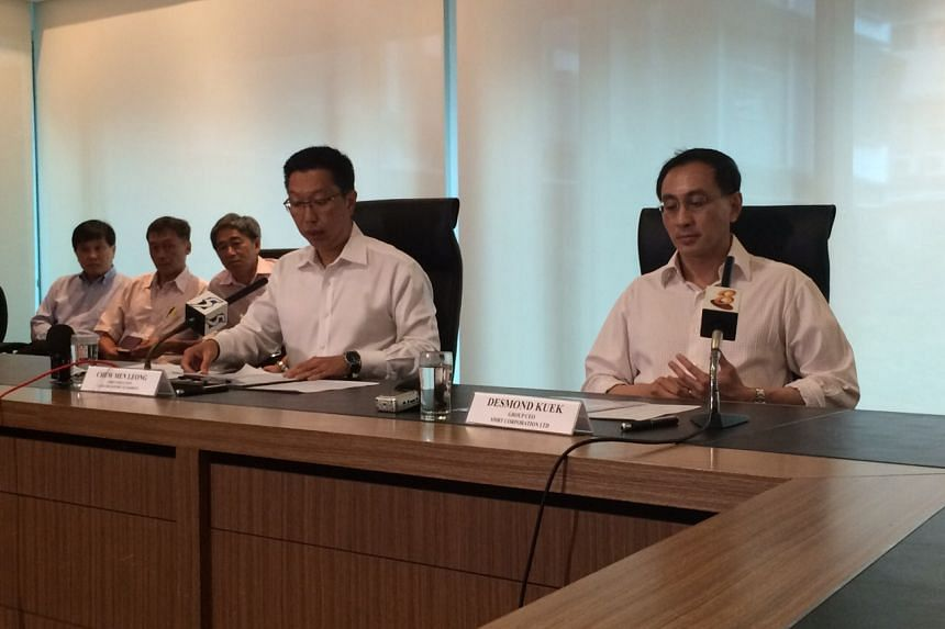 SMRT chief Desmond Kuek (right) and LTA chief Chew Men Leong (left) at a technical briefing at LTA's headquarters.