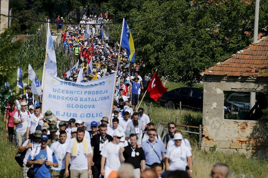 People march near the village of Nezuk, in Bosnia and Herzegovina.