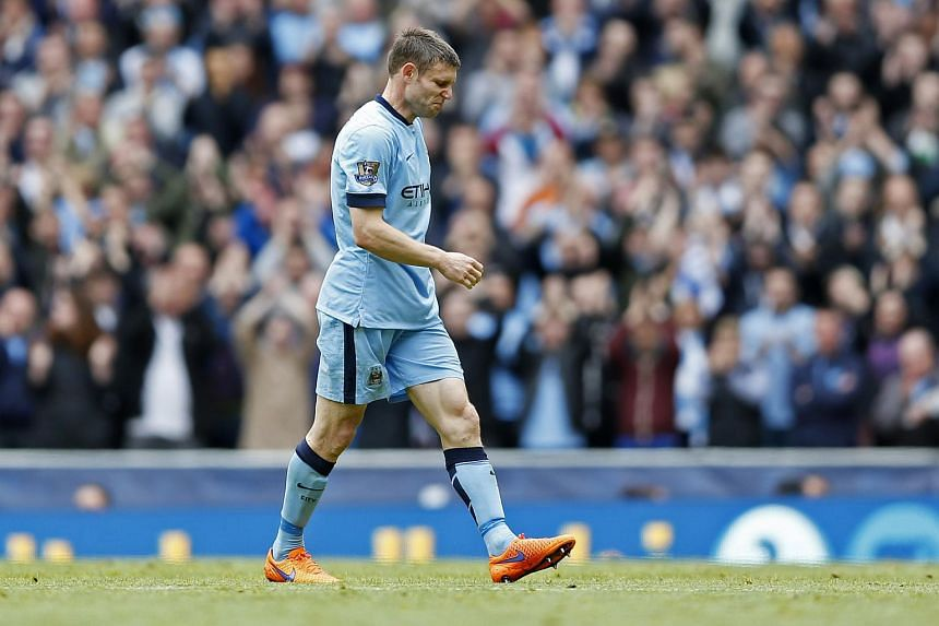 Manchester City's James Milner walks off as he is substituted during a match against Southampton.