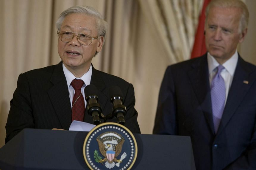 Vice-President Joe Biden (right) listens as General Secretary Nguyen Phu Trong speaks before a luncheon at the US State Department.