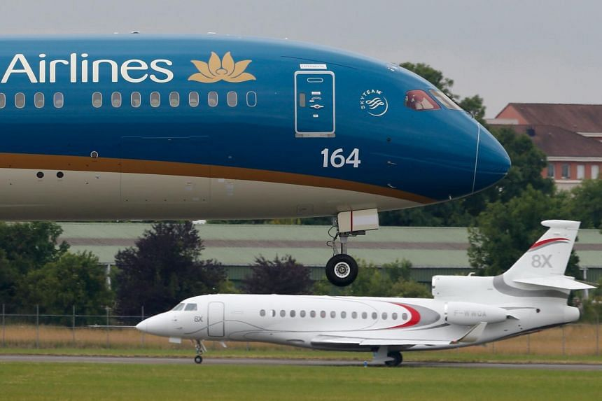 A Vietnam Airlines Boeing 787-9 Dreamliner landing after a flying display during the 51st Paris Air Show at Le Bourget airport near Paris last month. Boeing Co and Vietnam Airlines have agreed to negotiate the sale of eight 787-10 Dreamliners and eig