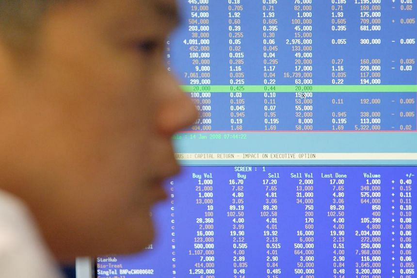 A file picture of a trader watching stock prices. Asian shares tumbled on Wednesday and the safe-haven yen rallied as Chinese stocks remained in a tailspin, shaking investors already rattled by Greece's debt crisis. PHOTO: BLOOMBERG