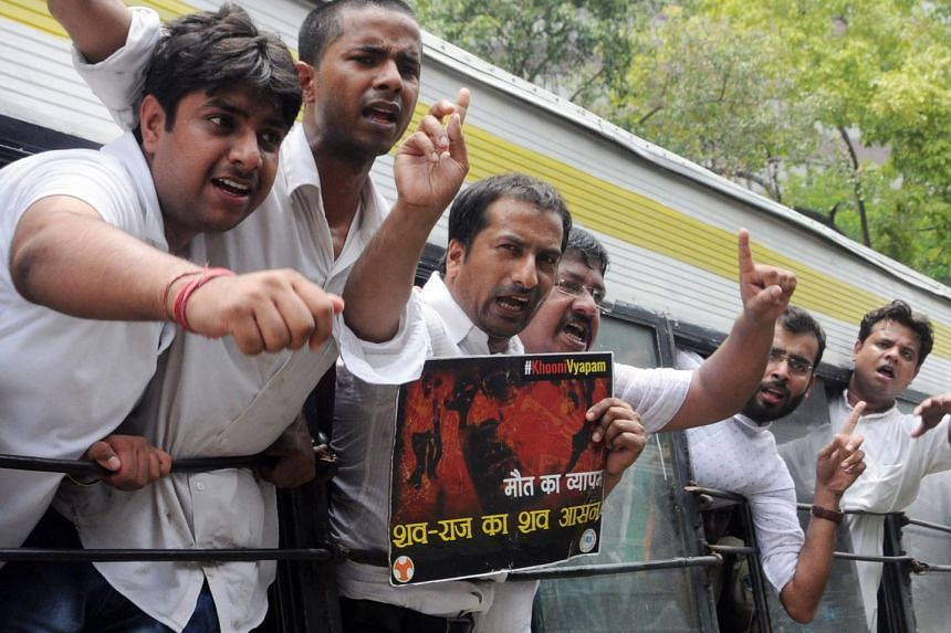 Youth Congress activists protest near a Bharatiya Janata Party (BJP) office against a series of deaths over the Madhya Pradesh Professional Examination Board and Vyapam scam in New Delhi, India, on July 8, 2015.