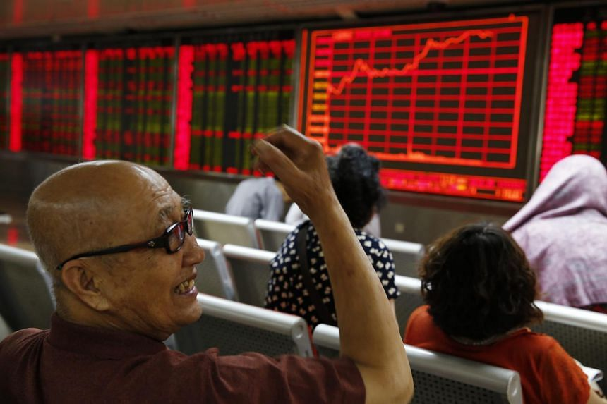 Chinese investors watching market movements at a securities brokerage house in Beijing, July 9, 2015.