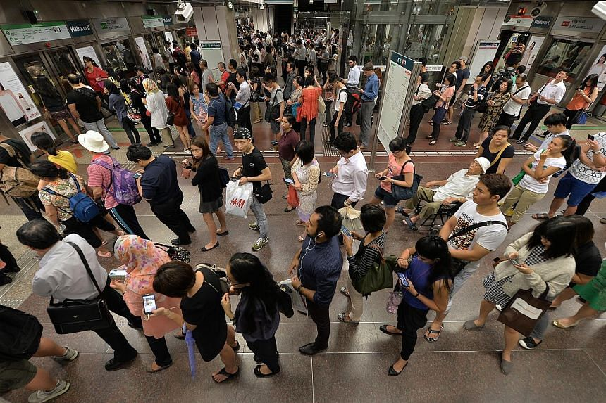 Long queues at City Hall MRT station after the major train disruptions on the North-South and East-West lines on July 7, 2015.