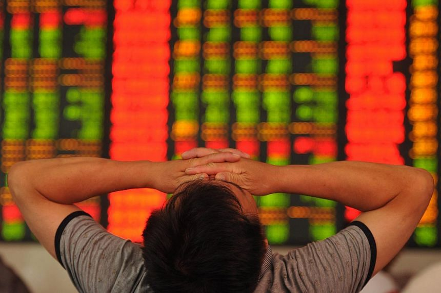 A stock investor reacts as he checks prices in a brokerage house in Fuyang in central China's Anhui province on July 8, 2015.