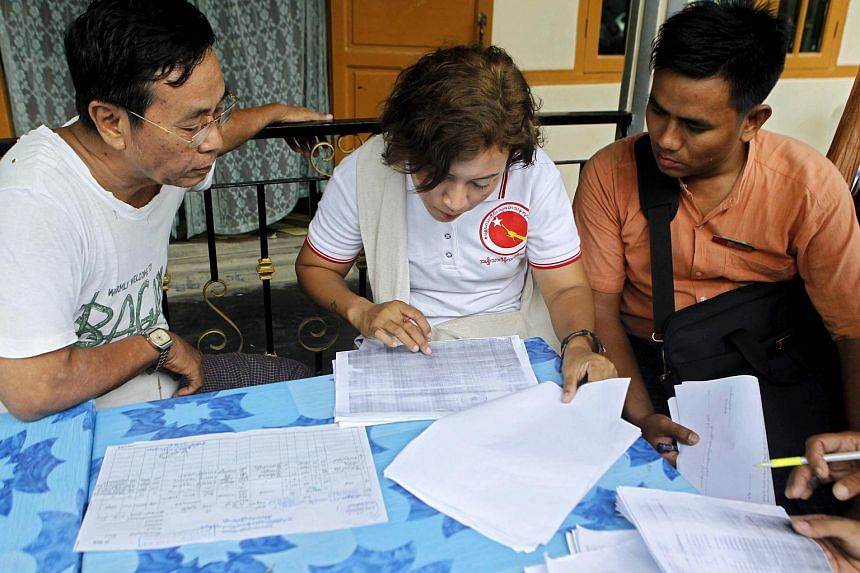 Members of Myanmar's National League for Democracy checking voter lists in Mandalay.