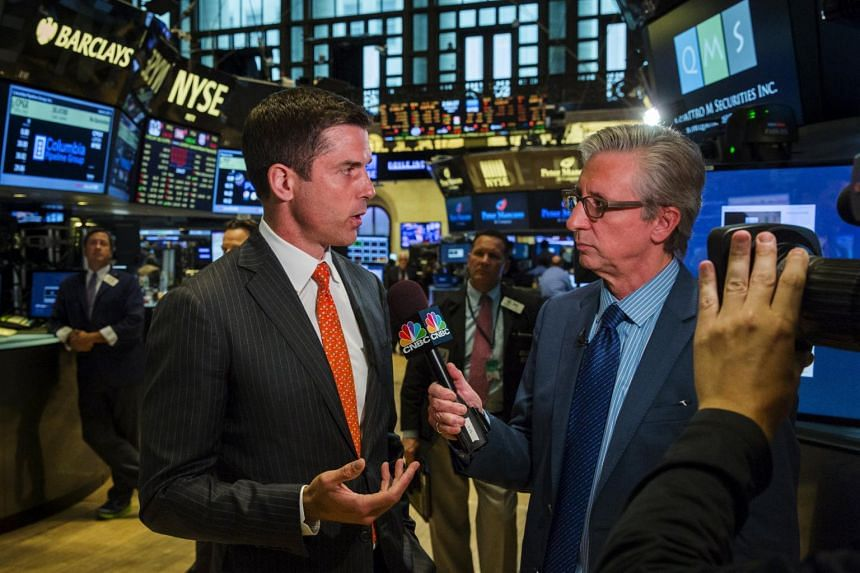 Tom Farley, president of NYSE Group is interviewed on the floor of the New York Stock Exchange following the stop in trading.