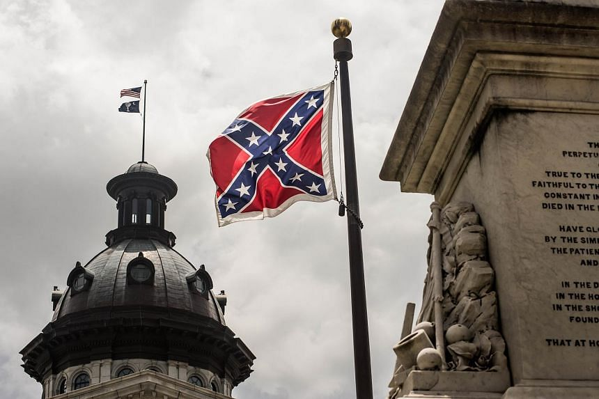 The Confederate battle flag flies at the South Carolina state house grounds on July 8, 2015 in Columbia, South Carolina.