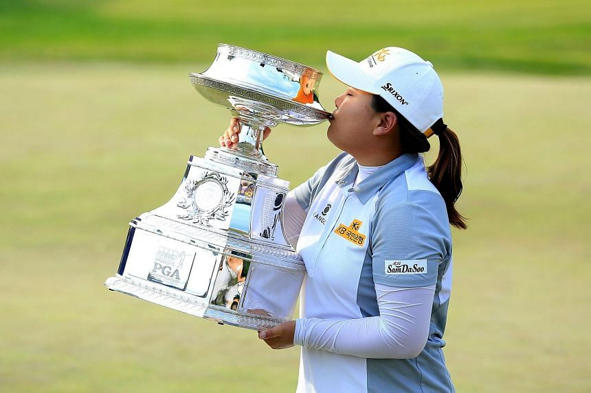 Inbee Park of South Korea proudly holds the trophy after her 5 shot victory in the final round of the 2015 KPMG Women's PGA Championship.