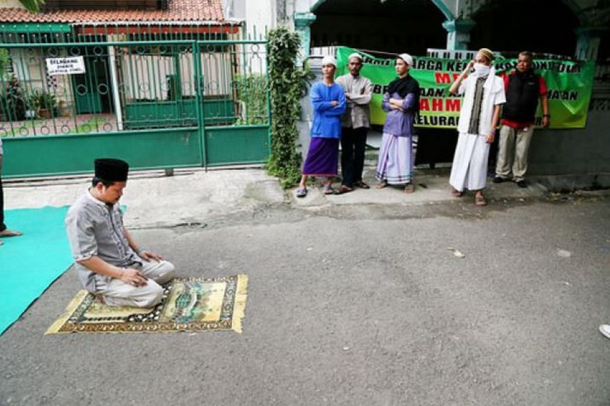 An Ahmadiyah follower saying his Friday prayers on the street in Bukit Duri Tanjakan, South Jakarta, on June 12, 2015, after hardline Islamic supporters blocked him from his mosque.