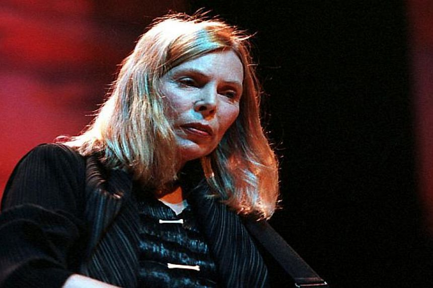 Joni Mitchell performs in a file photo.