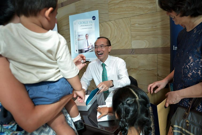 Former Foreign Minister George Yeo during the signing of his newly launched book, George Yeo On Bonsai, Banyan And The Tao at the Esplanade.