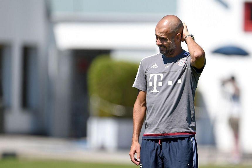 Bayern Munich's head coach Pep Guardiola attends a training session in Munich.