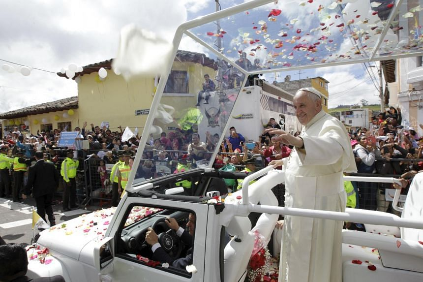 """Pope Francis waves to the faithful from the """"pope-mobile"""" in El Quinche, Ecuador, July 8, 2015."""