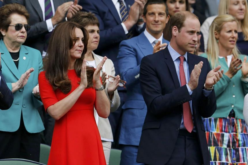 Catherine, Duchess of Cambridge, and Prince William (right) applaud as Andy Murray comes out to play.