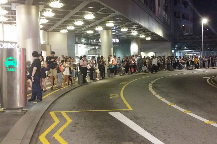 The taxi queue outside Raffles City shopping mall on July 7.