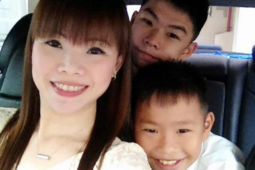 Ms Annie Lim, 41, started driving a taxi for her two teenage sons, Aloysius Teo, 18, (middle) and Alvin Teo, 13.