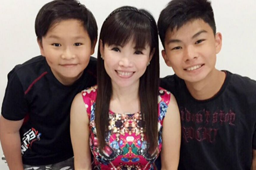 Ms Annie Lim with her two sons.