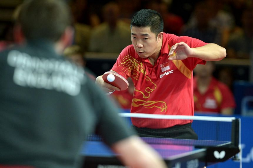 Singapore's veteran Zhan Jian won both his singles clashes in the showdown against England though he had to overcome the discomfort of pain in his right thigh.