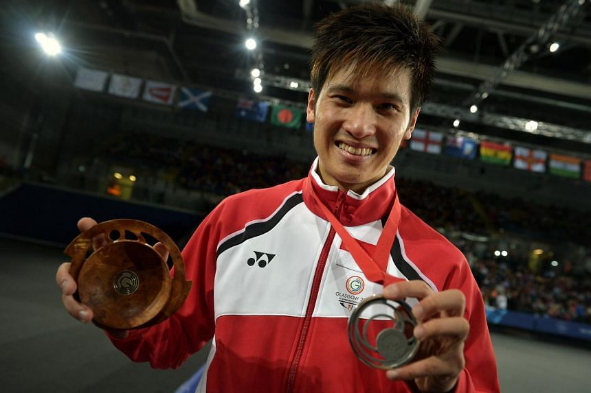 Singapore shuttler Derek Wong with the silver medal he won for the badminton Men's singles final game at the Emirates Arena during the 2014 Commonwealth Games in Glasgow, Scotland.