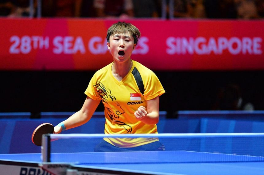Singapore's Feng Tianwei celebrates after winning a point at the Women's Team table tennis finals of the 28th SEA Games played at the Singapore Indoor Stadium on June 8, 2015.