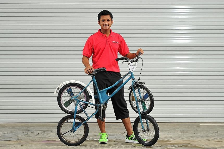 Bikes 4 Fun's manager, Mr Mostapha Kamal, with one of his eye-catching creations: a 2-on-2 bicycle. He wants to teach children the value of being creative and reinventing.