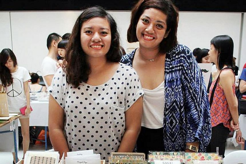 Sisters Hazirah (far left) and Fajrina Rahim and their range of stationery at a craft market.