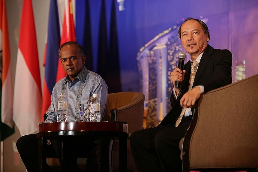 Mr K. Shanmugam with Dr Lim Lan Yuan at the dialogue session yesterday. The minister tackled questions on topics ranging from property cooling efforts to the Greek debt crisis and the stock selldown in China.