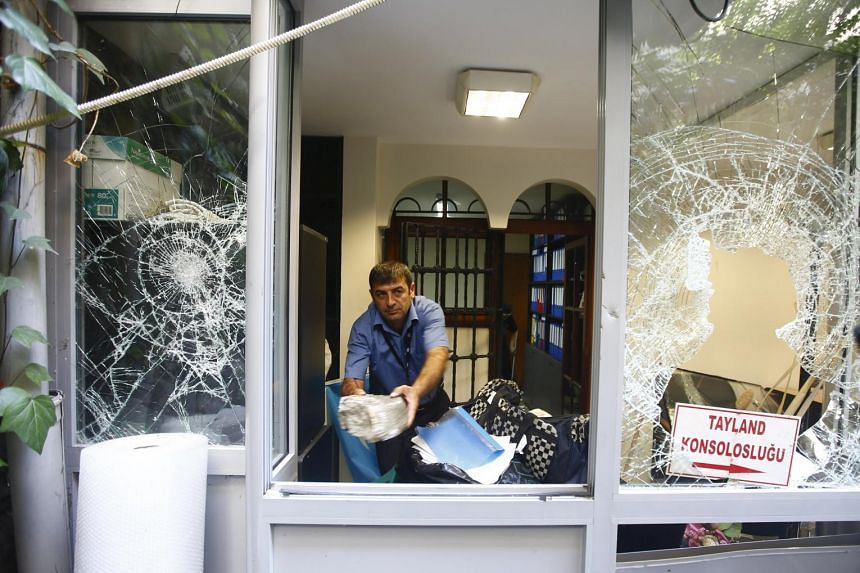 A man removes stones at the Thai honorary consulate in Istanbul.