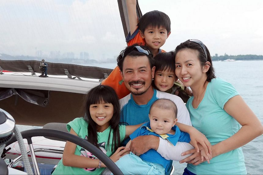Darren Lim and Evelyn Tan with their children (clockwise from left) Kristen, Jairus, Way and Elliott on their Lagoon 400S2.