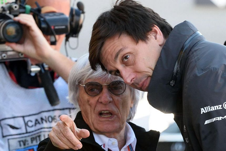 Bernie Ecclestone (left), chief executive of the Formula One Group, talking with Toto Wolff, head of Mercedes Benz Motor-Sport.