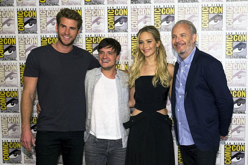 (From right) Hunger Games director Francis Lawrence with cast members Jennifer Lawrence, Josh Hutcherson and Liam Hemsworth at the 2015 Comic-Con International Convention.