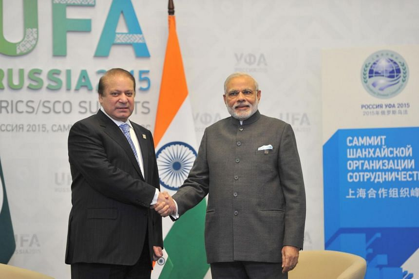 In this handout photograph released by The Indian Press Information Bureau (PIB) on July 10, 2015, India's Prime Minister Narendra Modi (right) shakes hands with Pakistan Prime Minister Nawaz Sharif.