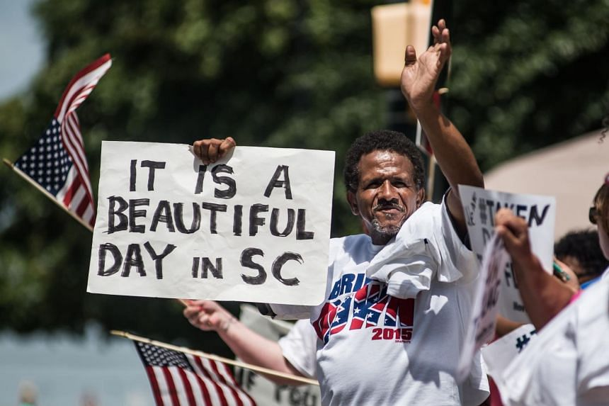 South Carolina on Friday permanently removed the Confederate battle flag from the state capitol grounds, sending away the rebel banner that is a symbol of slavery and racism to many but of Southern heritage and pride to others.