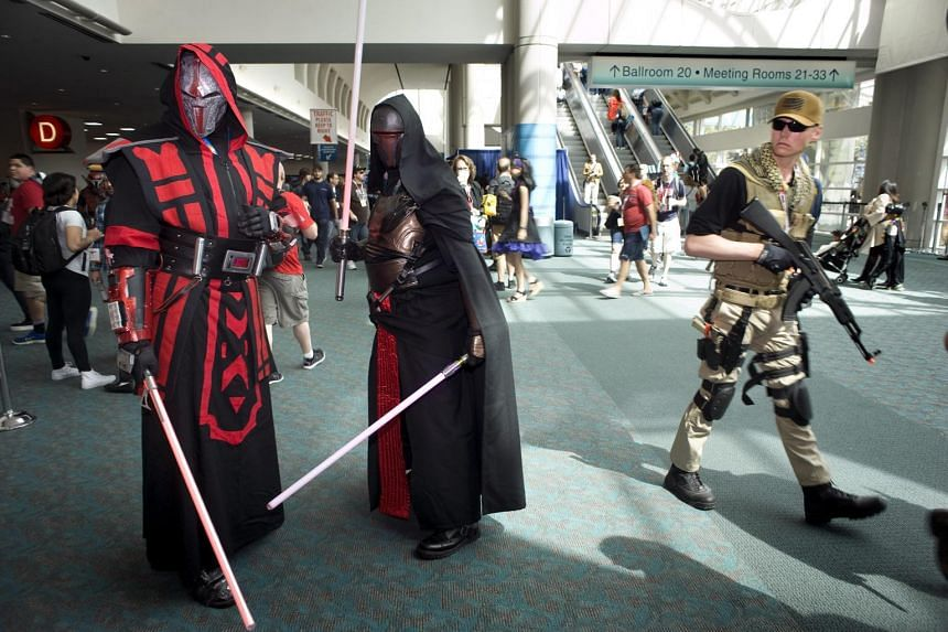 Comic-Con convention goers mingle on the second day of Comic-Con 2015, in San Diego, California, on July 10, 2015.