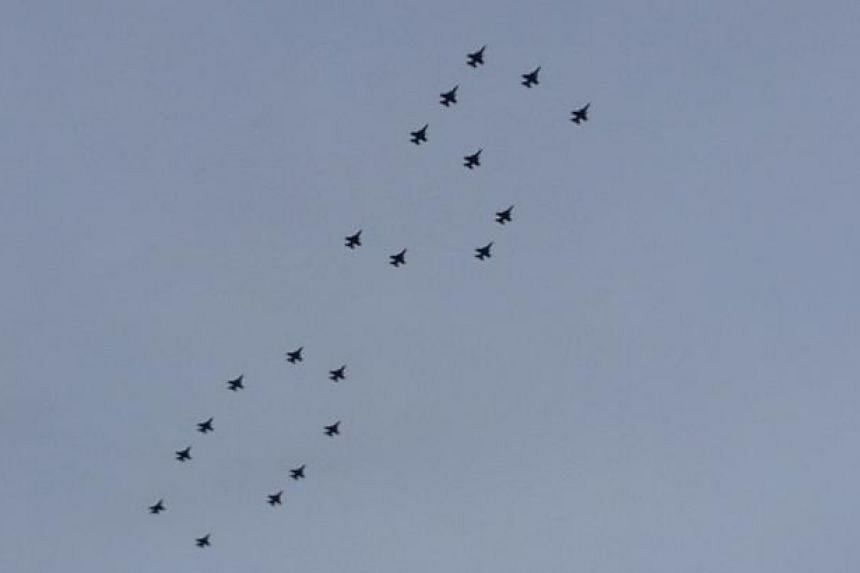 Jets from the NDP rehearsal flying past the Botanic Gardens during the concert.